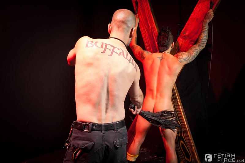 FistingCentral Tony Buff dark room Draven Torres St Andrews cross taskmaster Mohawk muscle flogging raised welts 007 tube download torrent gallery sexpics photo - Tony Buff and Draven Torres